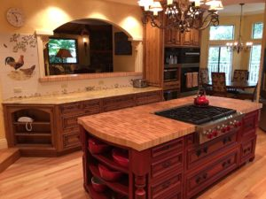 Custom Knotty Alder kitchen cabinetry and Island
