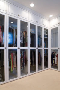 White closet with clear glass inserts