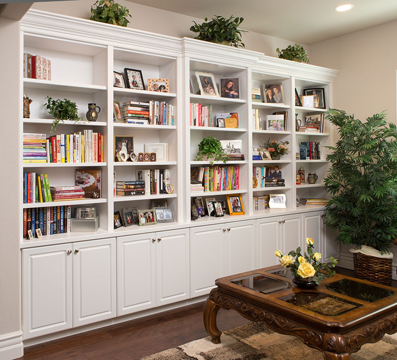 This Elegant, Painted Display Unit Provides A Wall Full Of Storage And  Display Space In The Family Room.