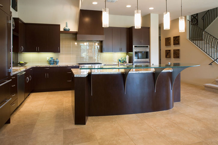 Contemporary kitchen cabinets with raised glass eating bar