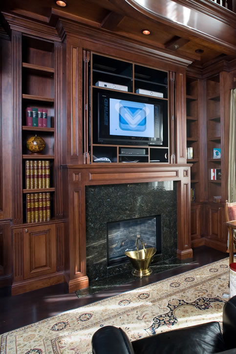 Media equipment storage over fireplace