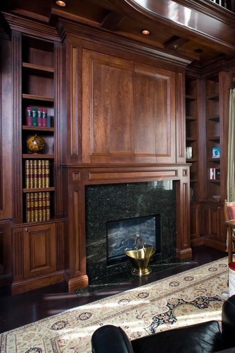 Bi-fold doors hide television over fireplace