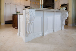 Traditional painted island cabinets with carved corbels