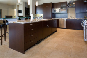 Contemporary kitchen with raised glass eating bar