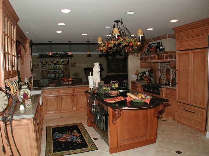 Cherry kitchen with mitered raised panel doors