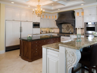 Painted kitchen cabinets with mahogany island